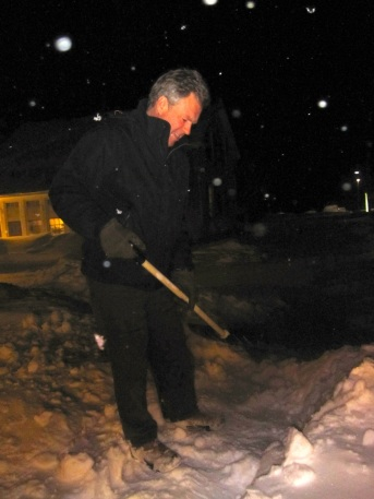 Chas Eller, after a snow storm, clearing the path from the rehearsal studio to the cars